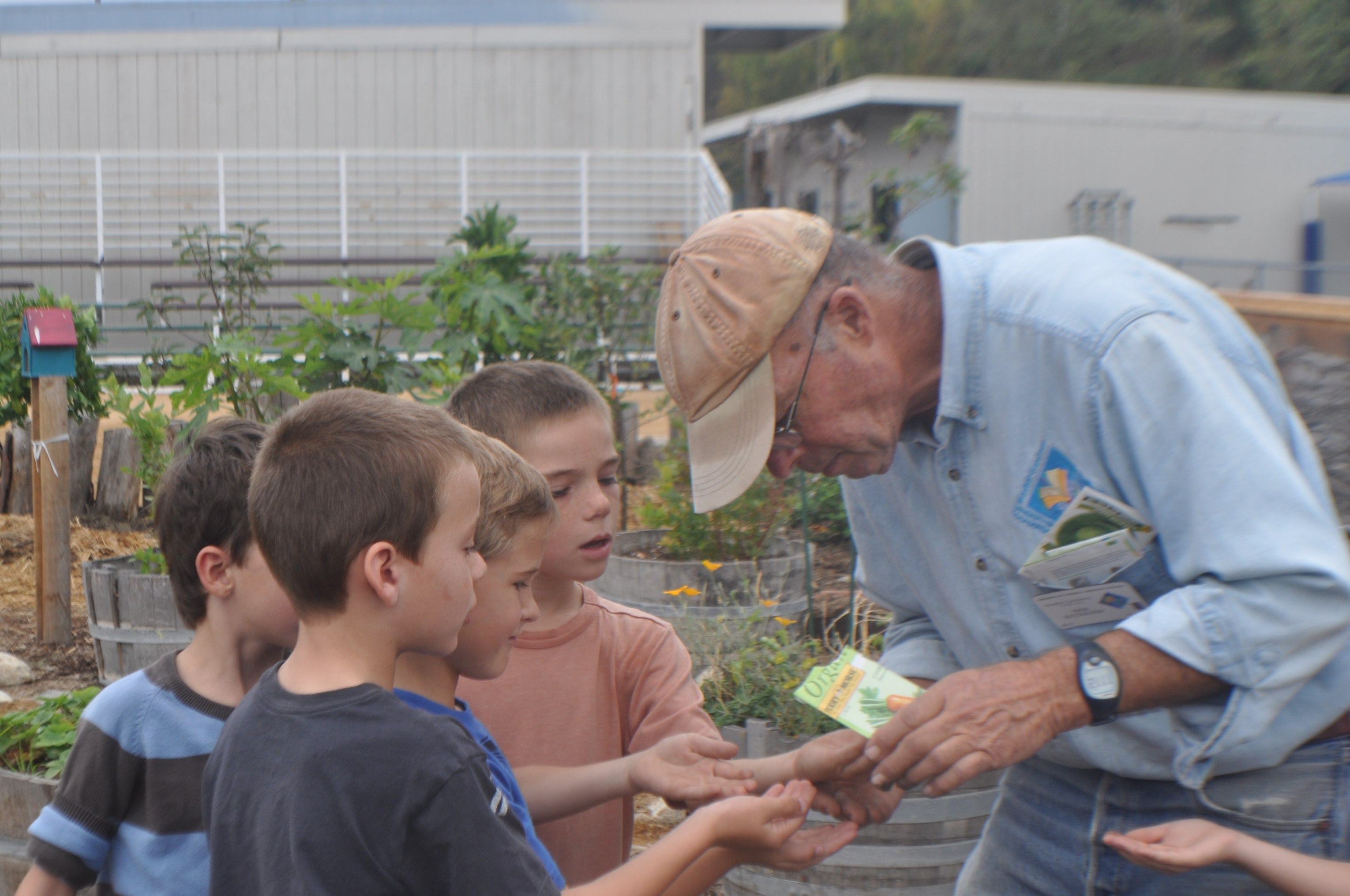 First graders planting seeds handed out by Master Gardener, Erik.