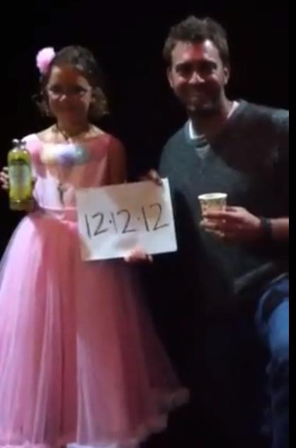 "Vivienne Harr, 8, and World Series Champ Jeremy Affeldt coming together to promote Vivienne's historic ""stand"" in Times Square on 12-12-12 to end child slavery."