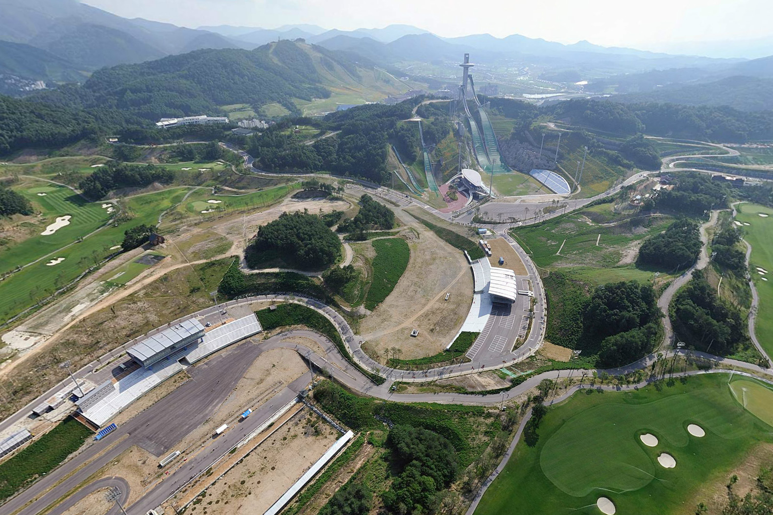 """The 2018 Winter Olympics site in PyeongChang, Korea is largely complete in a compact, """"light touch"""" plan by design-build team including Taeyoung, SWA Group and Space Group architects. Image courtesy Alpensia."""