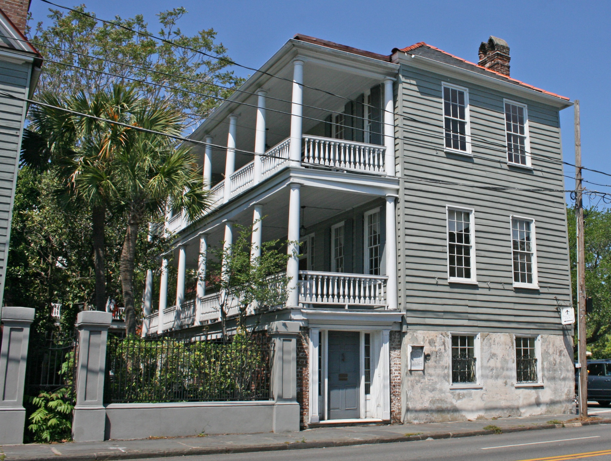 In charleston a historic hotel property 39 s lights go back for Charleston single house