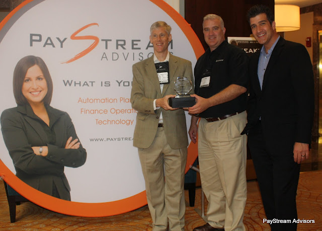 Henry Ijams from PayStream Advisors (left) presents award to Lavante