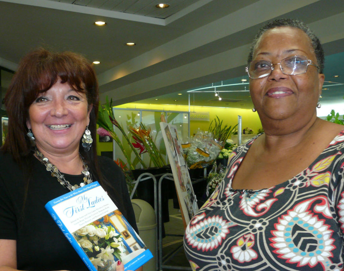 "Dorothy Pinto of Davie, FL ""Field of Flowers is a wonderful place to visit.  The flower selection is exceptional."" With AFID florist and store manager Isabel Casanas  (on left)"