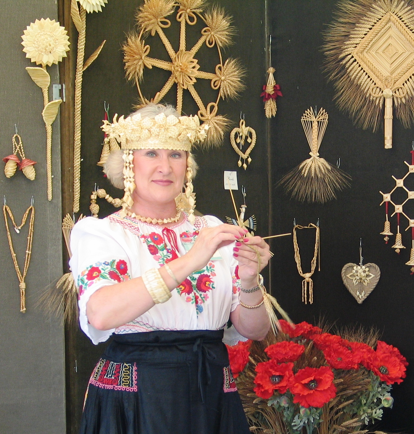 Sidonka Wadina of Lyons, WI shown with woven straw creations.