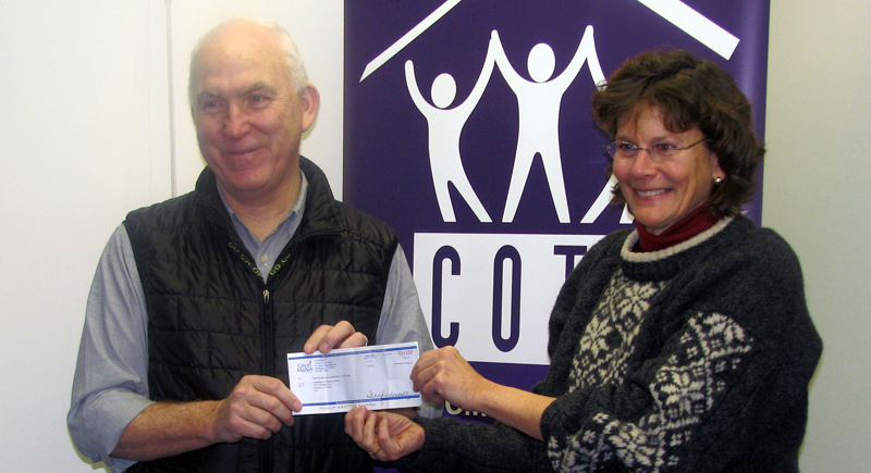 City Market General Manager Clem Nilan presents a check to COTS Executive Director Rita Markley