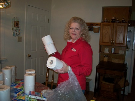 Bobbi Sullivan with rolls of toilet paper she will give out.