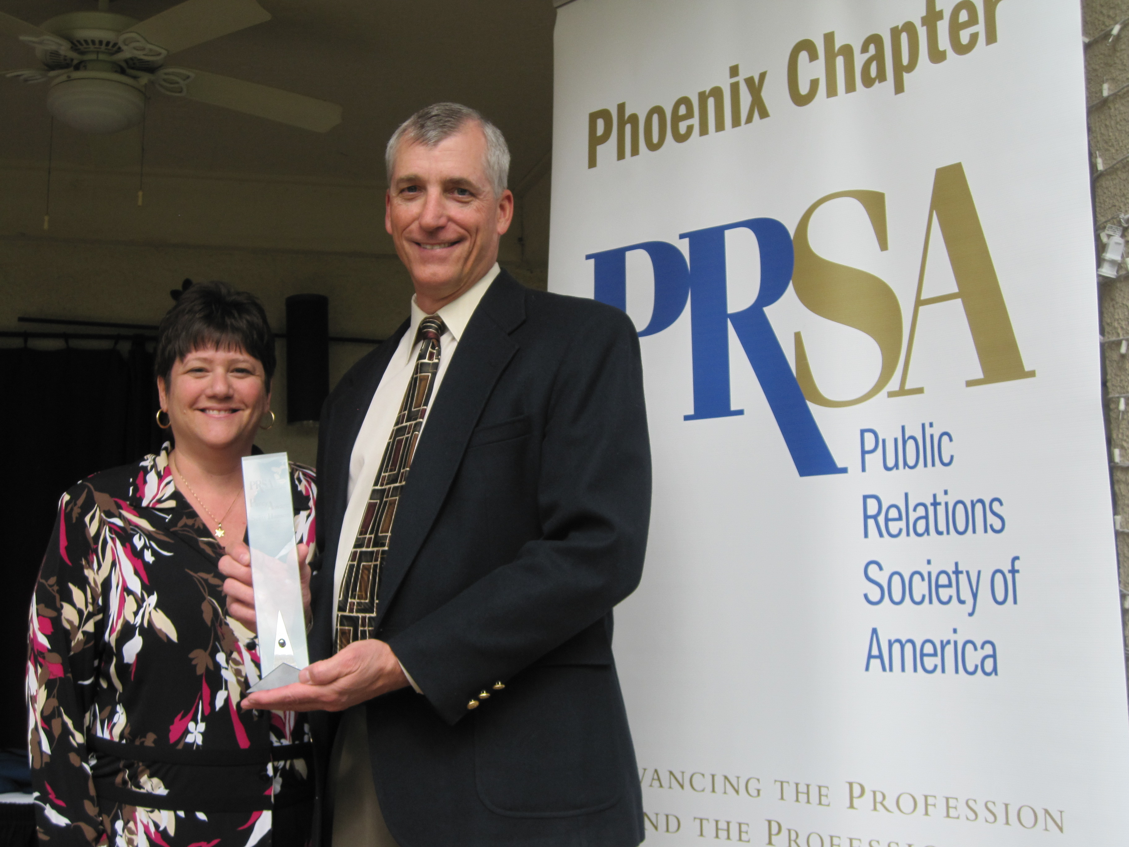 Scott Hanson with business partner Abbie S. Fink at the 2012 PRSA Phoenix Percy Awards. He will accept another lifetime achievement honor - the Emmy Silver Circle - on October 6.