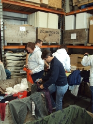 DaVita teammates help sort clothing as part of a recent Village Service Day.