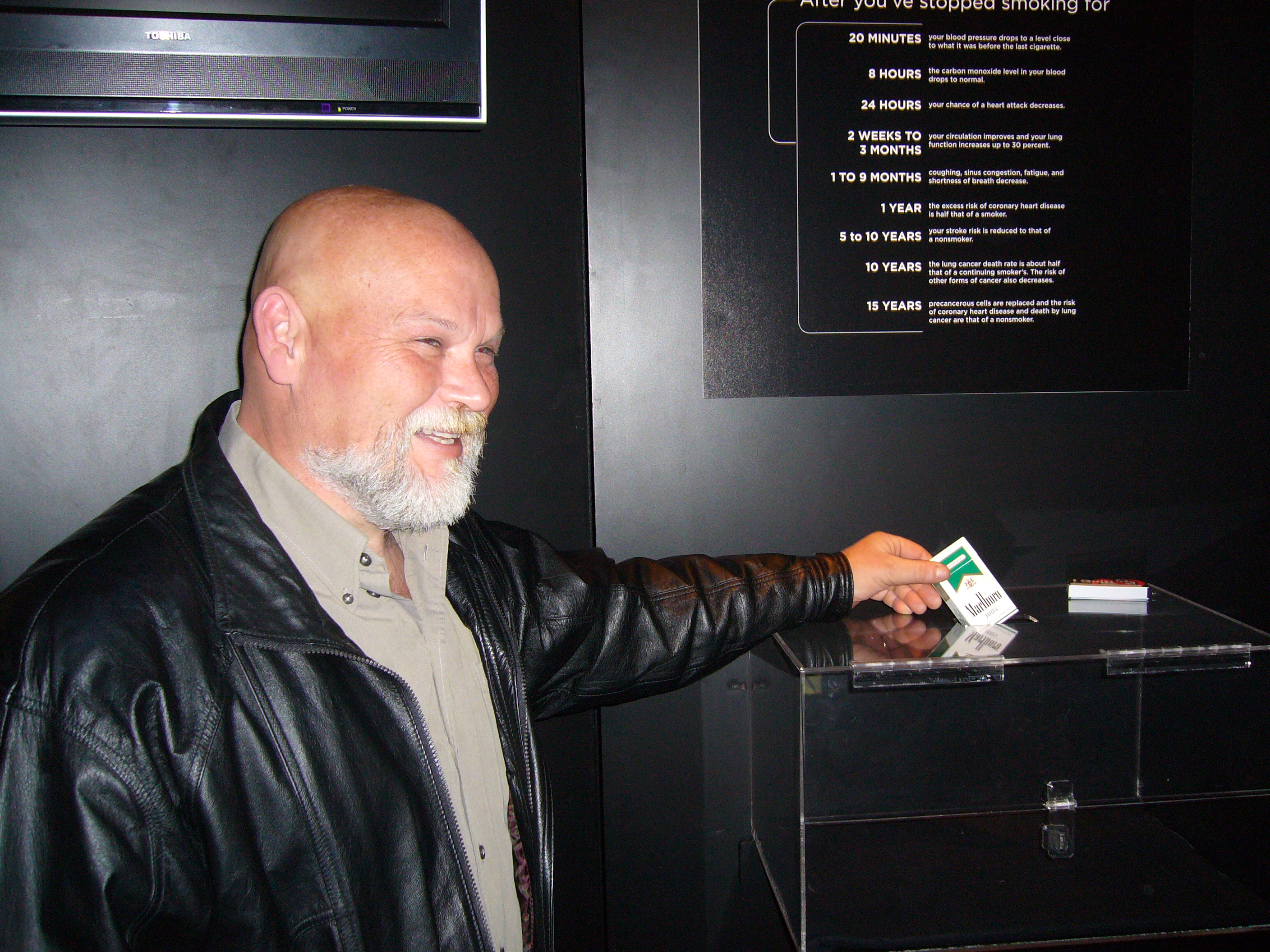"Salem, Oregon resident Brad Taylor surrenders his last pack of cigarettes at the ""I Quit"" unveiling at Gunther von Hagens' BODY WORLDS & The Brain"
