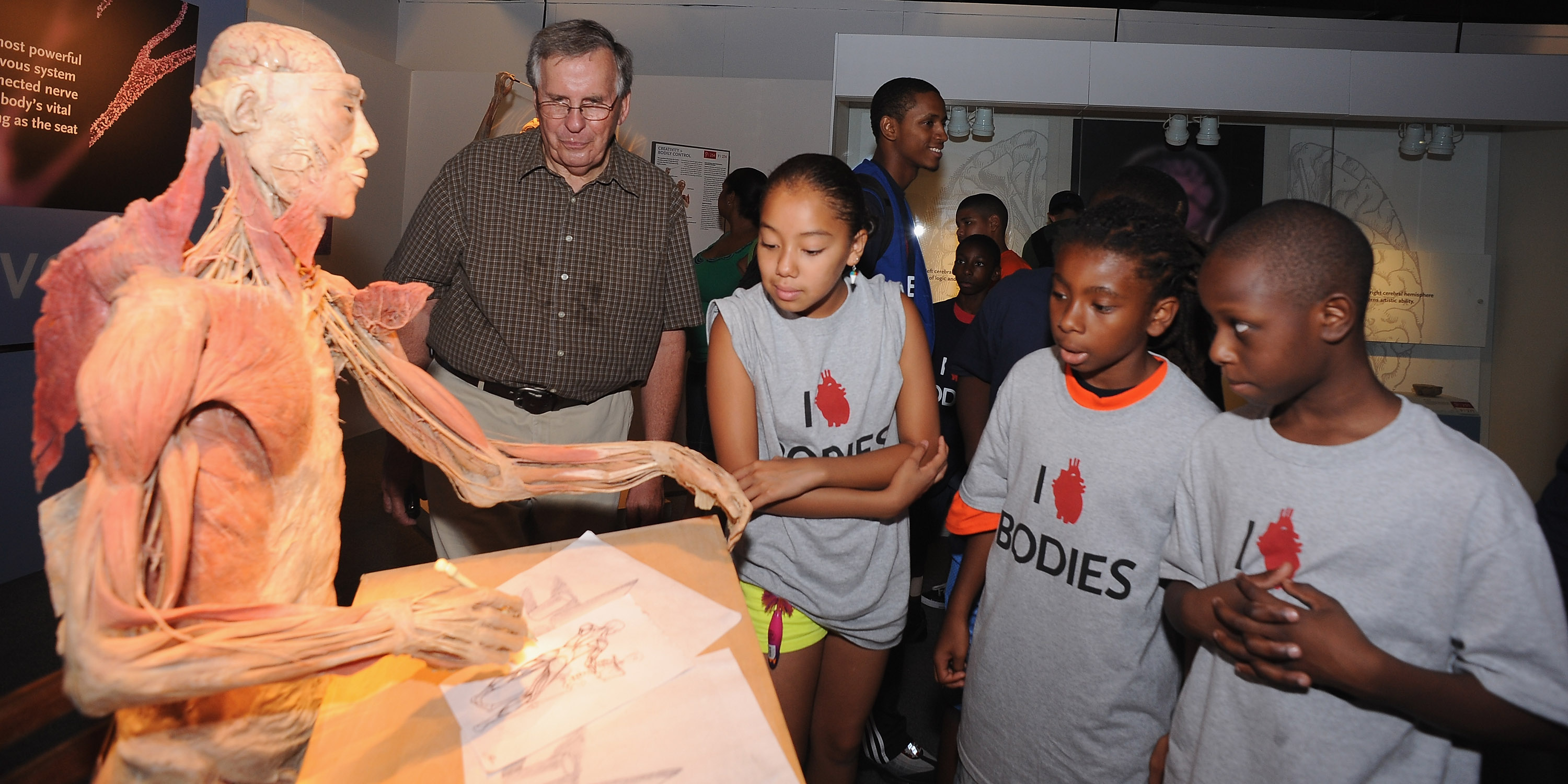 Dr. Glover and students from the Boys & Girls Club at BODIES...The Exhibition