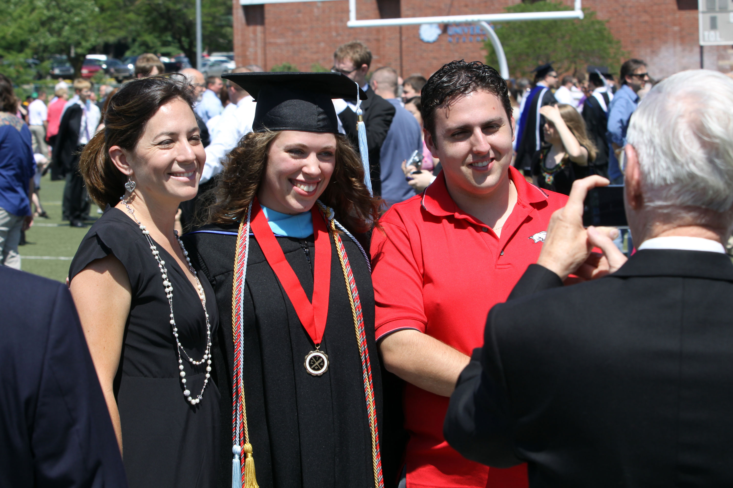 Dorothy Avery, one of Concordia University, Nebraska's 585 graduates, poses with family after commencement.