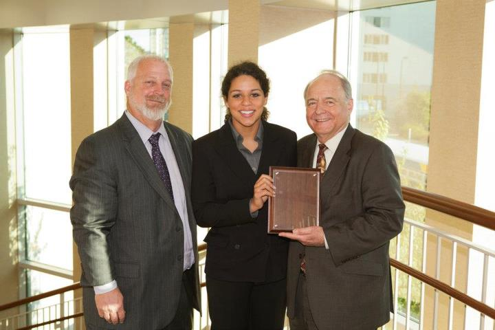 Solome Tibebu (center), winner of the 2011 Fowler Business Concept Challenge Undergraduate Division, poses with Dean Puto (left) and Dr. David Deeds (right). Photo courtesy of Tom Whisenand, University of St. Thomas.