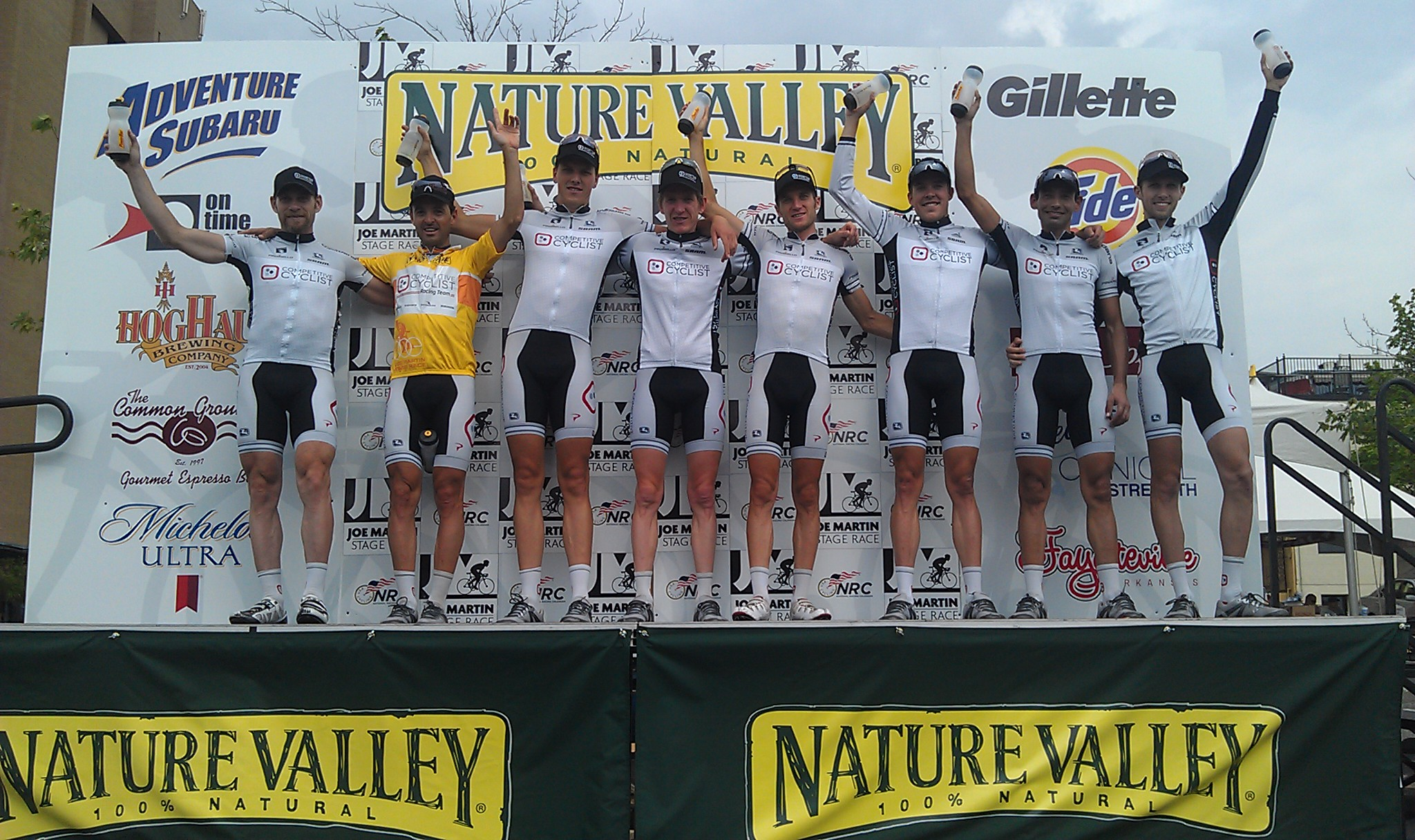 Competitive Cyclist Racing Team on top of the Joe Martin Stage Race podium. 