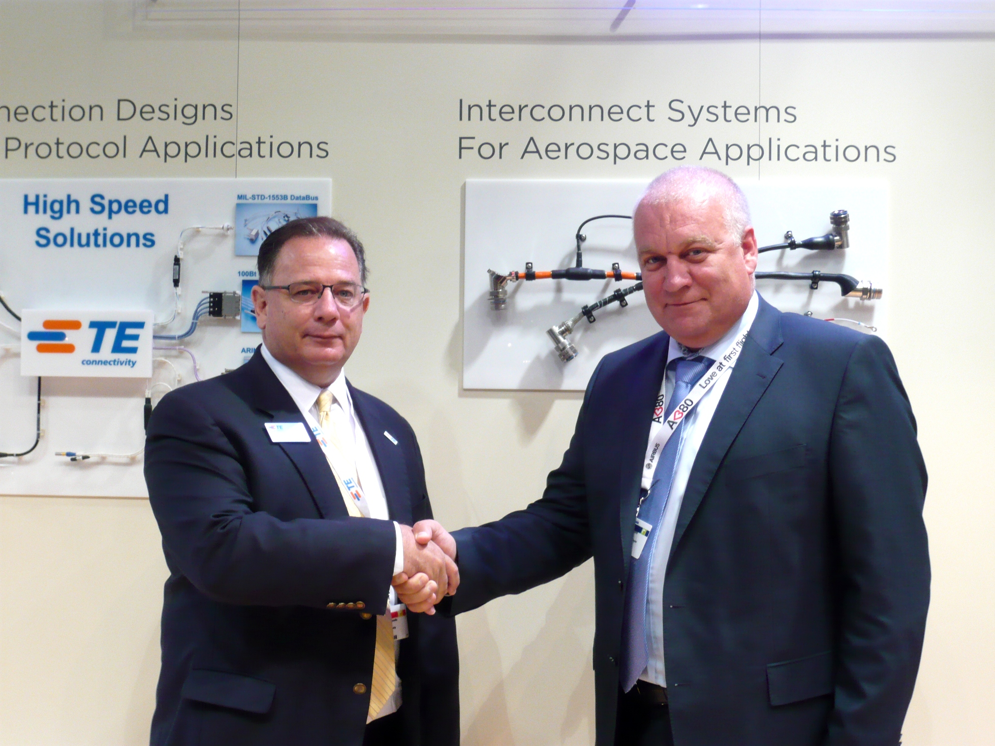 Frank Breslin (left), Vice President Global Sales, TE Connectivity - Aerospace, Defense & Marine, and Valery Shardin (right), President, Promtechkomplekt Co. Ltd. announce a new licensing agreement at Farnborough Airshow 2012.