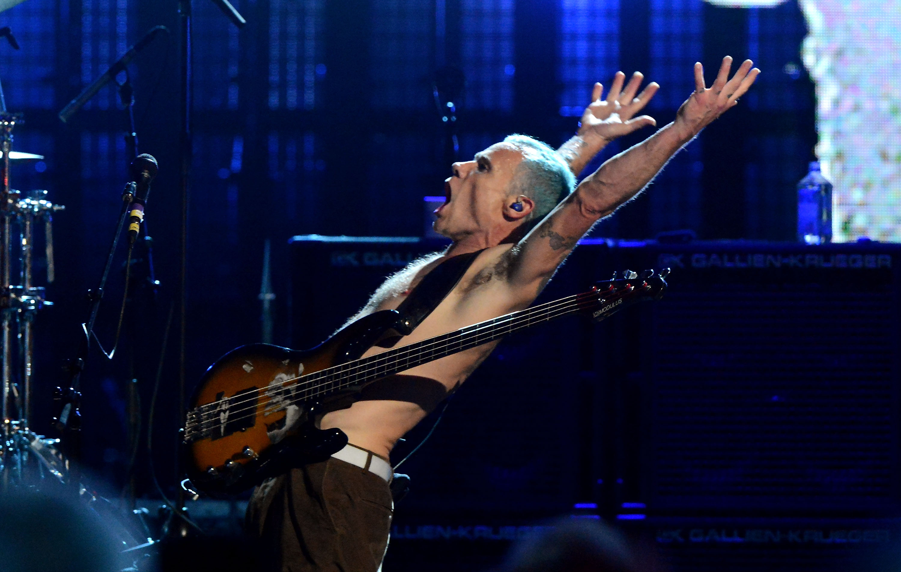CLEVELAND, OH - APRIL 14: Inductee Flea, of the Red Hot Chili Peppers, performs on stage at the 27th Annual Rock And Roll Hall Of Fame Induction Ceremony at Public Hall on April 14, 2012 in Cleveland, Ohio. (Photo by Jeff Kravitz/FilmMagic)