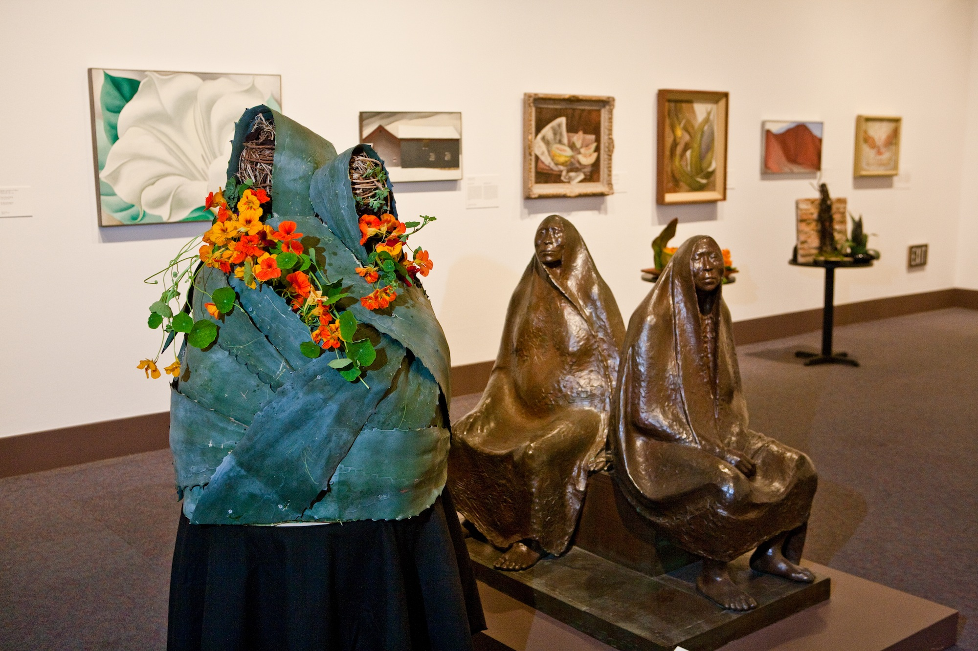 Floral interpretations of works of art from the Museum's permanent collection. Francisco Zúñiga. Mother and Daughter Seated, December 27, 1912-August 9, 1998. Bronze. 1971.27.