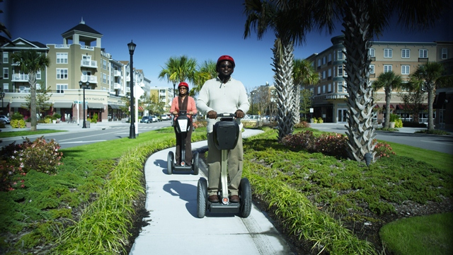 Couple riding segways at the Market Common in Myrtle Beach.