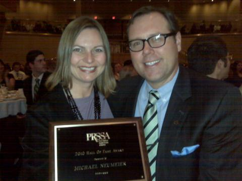 Sonja Popp-Stahly, APR, communications manager for Lilly Bio-Medicines and PRSSA national professional advisor, presents Arketi Principal Mike Neumeier, APR with the 2010 PRSSA Hall of Fame Award.