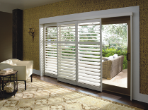 Hunter Douglas Palm BeachT polysatin shutters with the new exclusive DuraLuxT finish featuring the open louver bypass track system.  