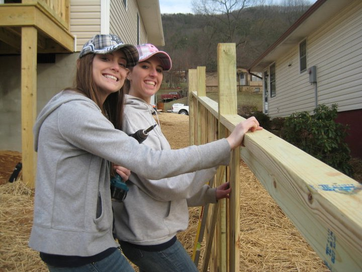 Champlain students, Liz Muroski '11 and Stef Welling '12 attaching pickets to a fence at their work site in Buena Vista, Virginia on their Spring Break 2011 Service Trip with Habitat for Humanity