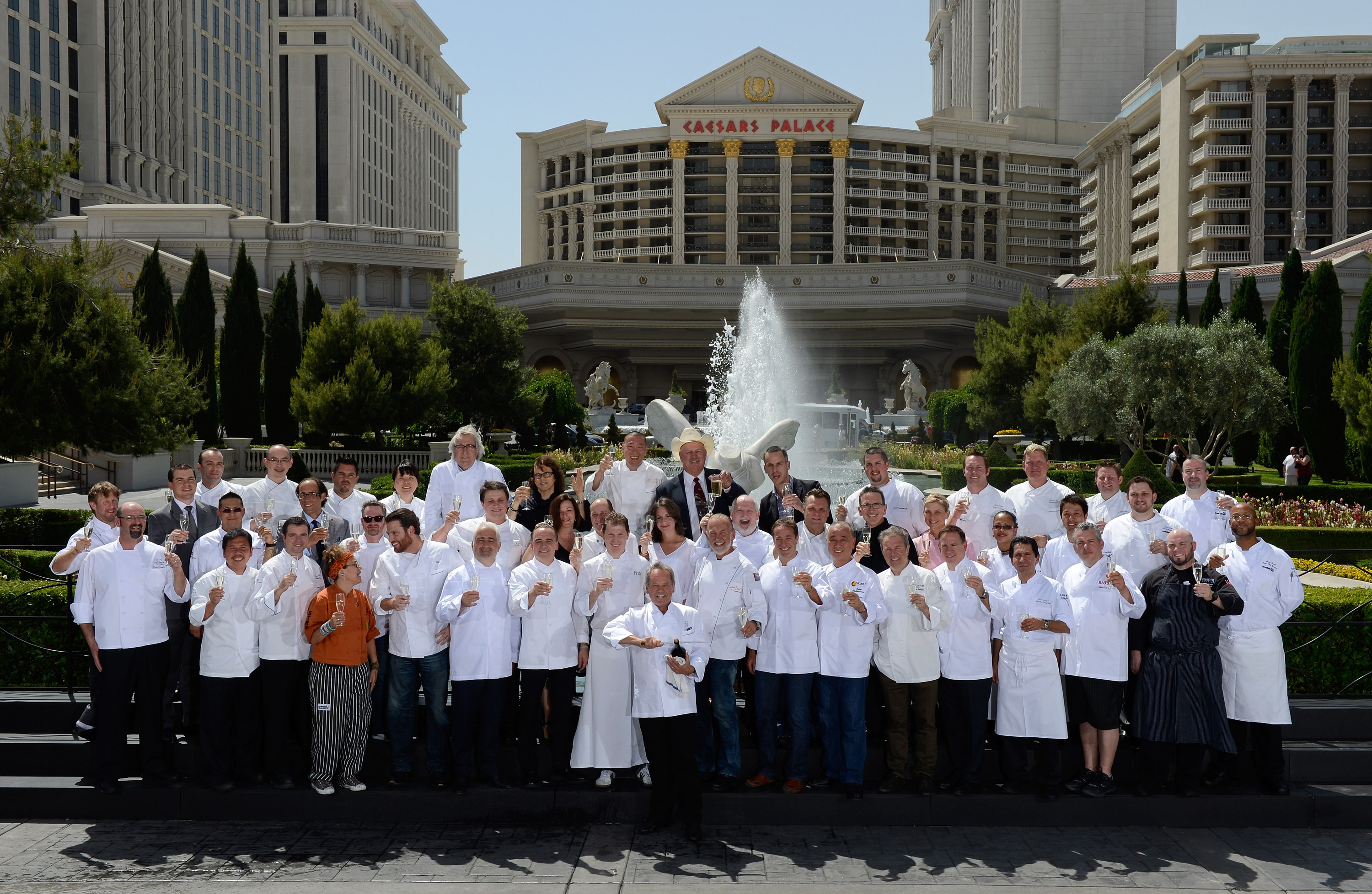 LAS VEGAS, NV - MAY 10: Chef Wolfgang Puck (C) along with chefs from the Bellagio, Caesars Palace, The Cosmopolitan of Las Vegas and the Mandalay Bay Resort &amp; Casino mark the beginning of the sixth annual Vegas Uncork&#39;d by Bon Appetit culinary festival and the 20th anniversary of Puck&#39;s Spago restaurant with a ceremonial Mionetto Prosecco saber-off in front of Caesars Palace May 10, 2012 in Las Vegas, Nevada. (Photo by Ethan Miller/Getty Images for Vegas Uncork&#39;d)