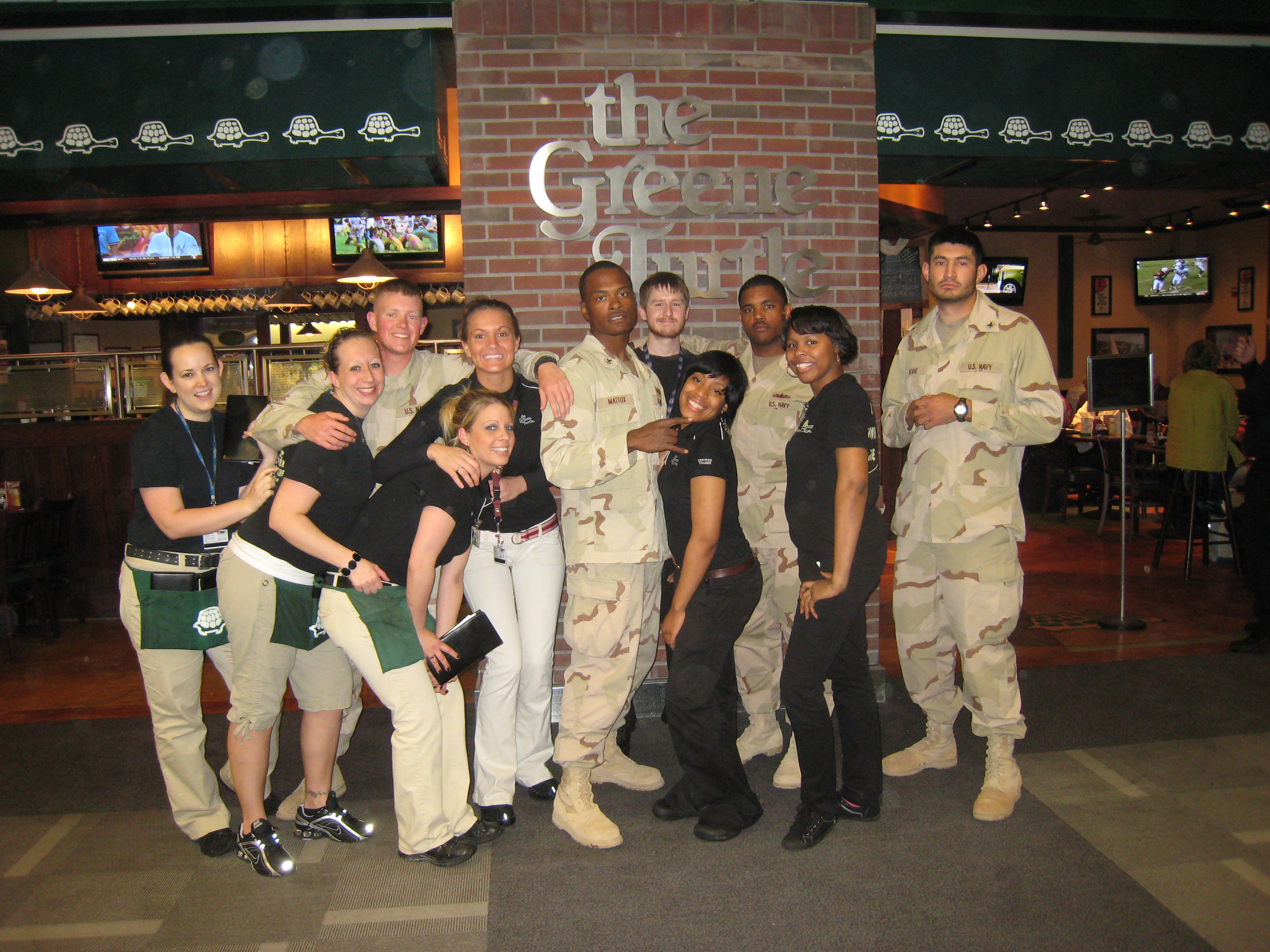 Staff at The Greene Turtle's BWI Airport location welcome active military personnel.