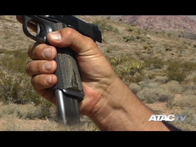 1911 handgun magazine reload
