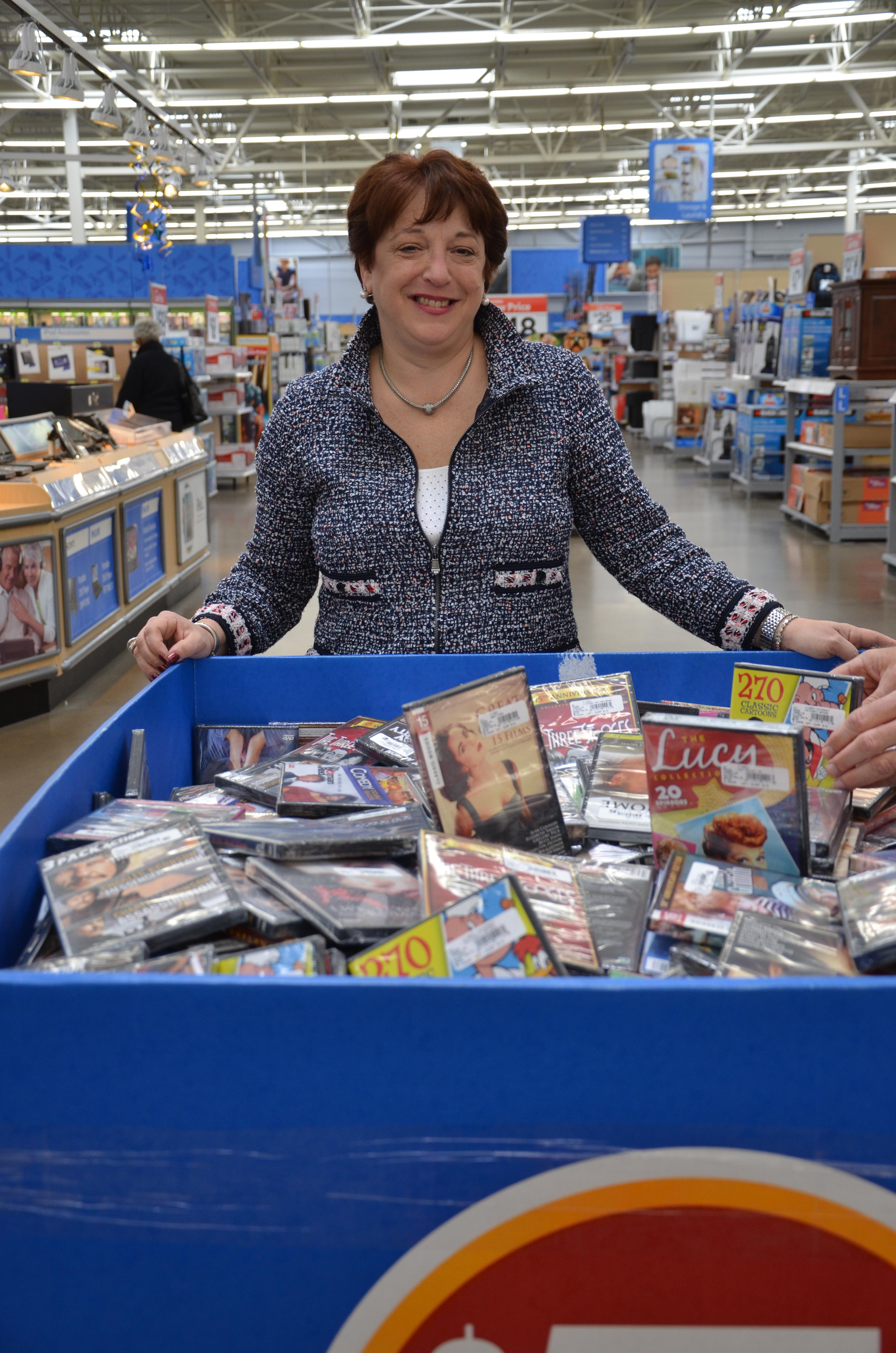 Emily Gottschalk, founder and CEO of TGG Direct, poses with a bin of her products at the Wal-Mart in Somerdale, NJ.