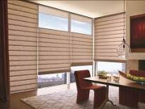 Alustrar Vignetter Modern Roman Shades from Hunter Douglas in the Drake fabric with a natural raw silk texture. 
