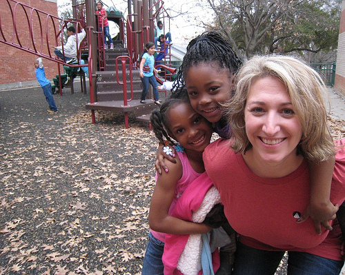 Volunteer Cara made several new friends (and gave lots of piggy-back rides) on the playground during a company volunteer event at the Boys & Girls Club's Plano branch in 2011.