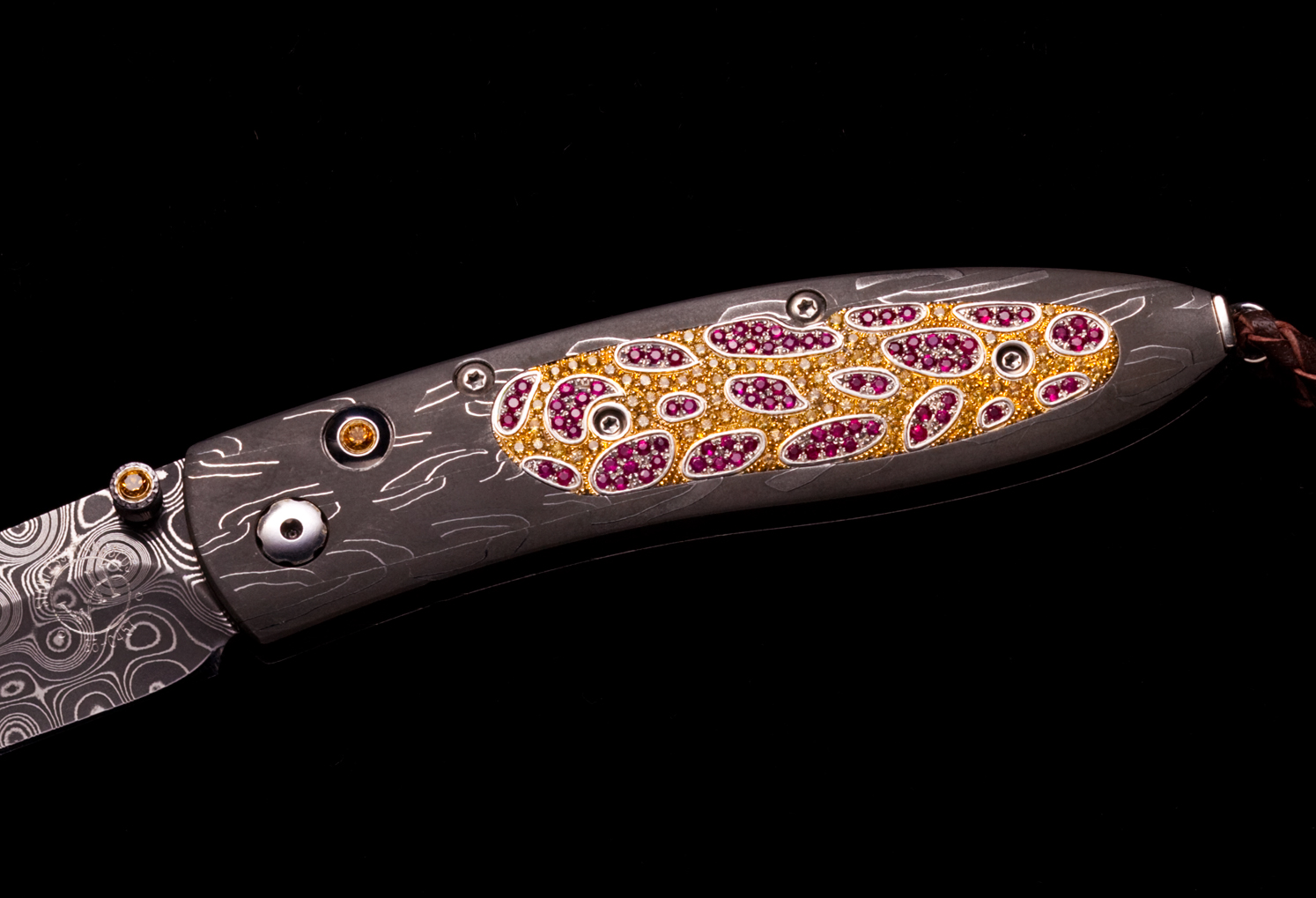 The B05 'Monarch' pocketknife inlaid with a pave of 168 rubies (1.86K) and 158 yellow sapphires (1.607K)
