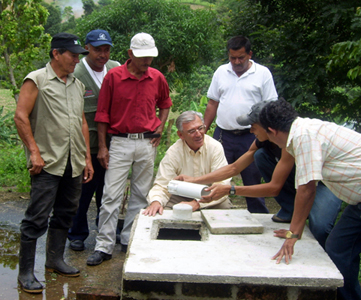 CTI volunteer Program Manager Jorge Fernandez (center) inspects a Water Chlorinator installation with a volunteer water committee in Nicaragua.