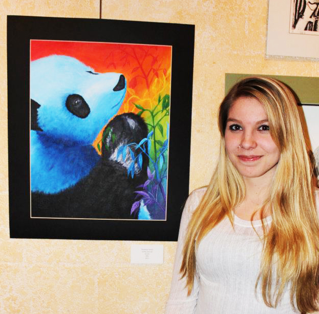 Ashley Kennah with her painting Rainbow Panda