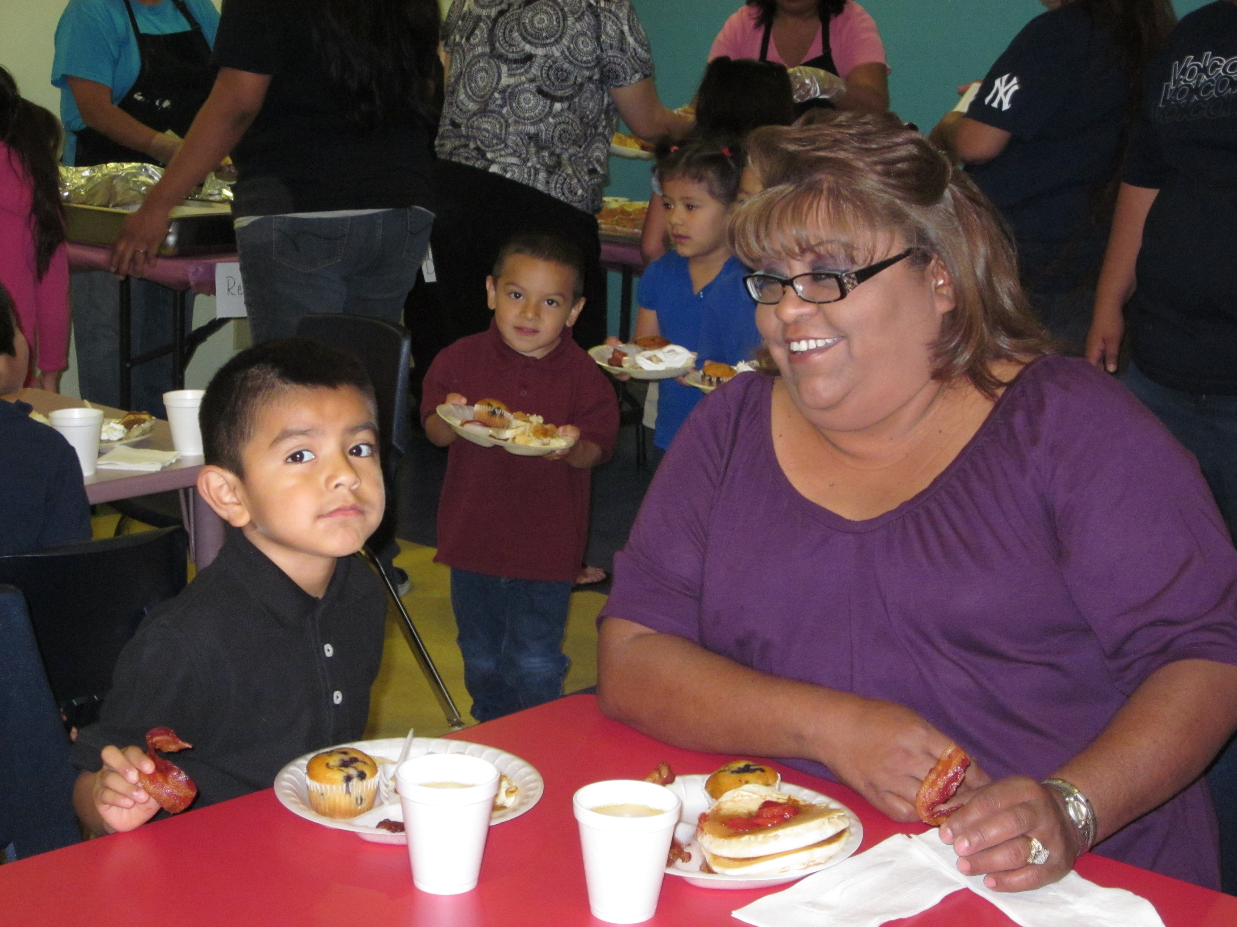 - Ida Soliz & Grandson, Draven Soliz sit down to eat their Pancake Breakfast; a part of week-long activities commemorating the Week of the Young Child.