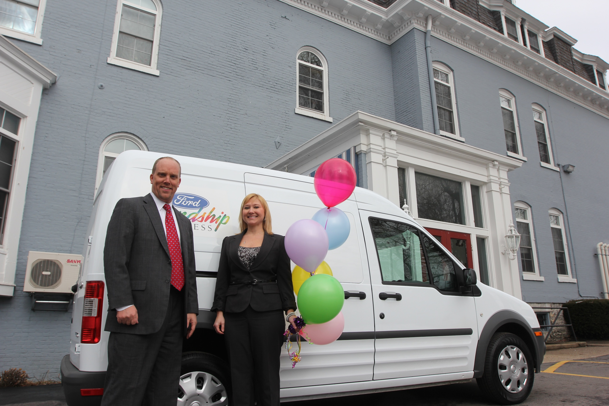 Mike Helbringer and Lisa Schlenker of The Bristol Home pose with their new 2012 Ford Friendship Express van