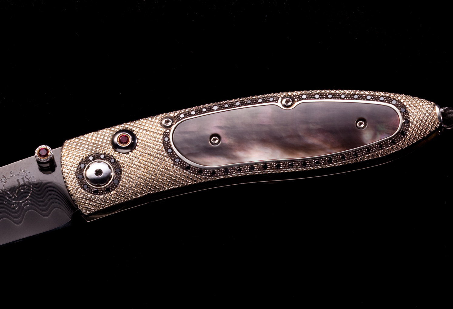 The B05 'Monarch' pocketknife inlaid with black lip pearl and 100 black diamonds (1.18K).