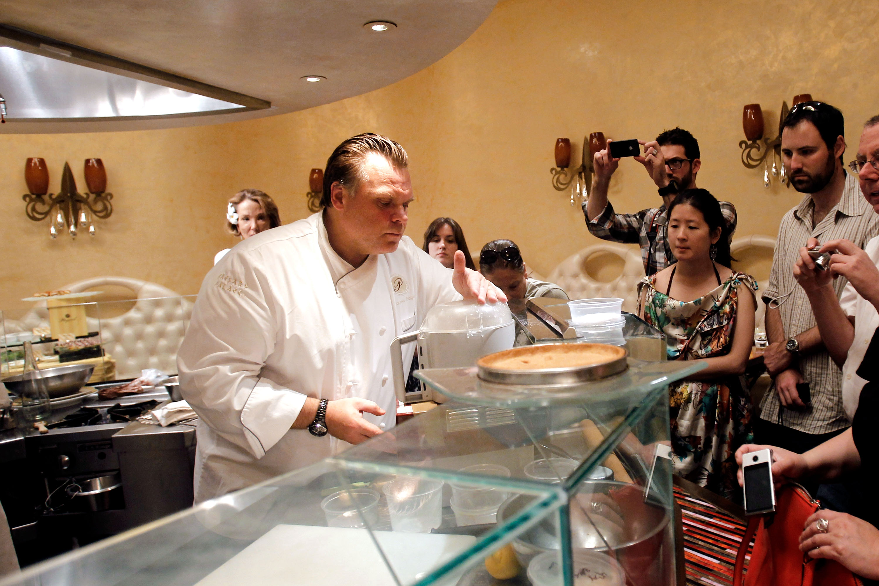 Guests watch Francois Payard serve up some of his delectable desserts at Payard Patisserie &amp; Bistro at Caesars Palace (photo credit: Isaac Brekken) 