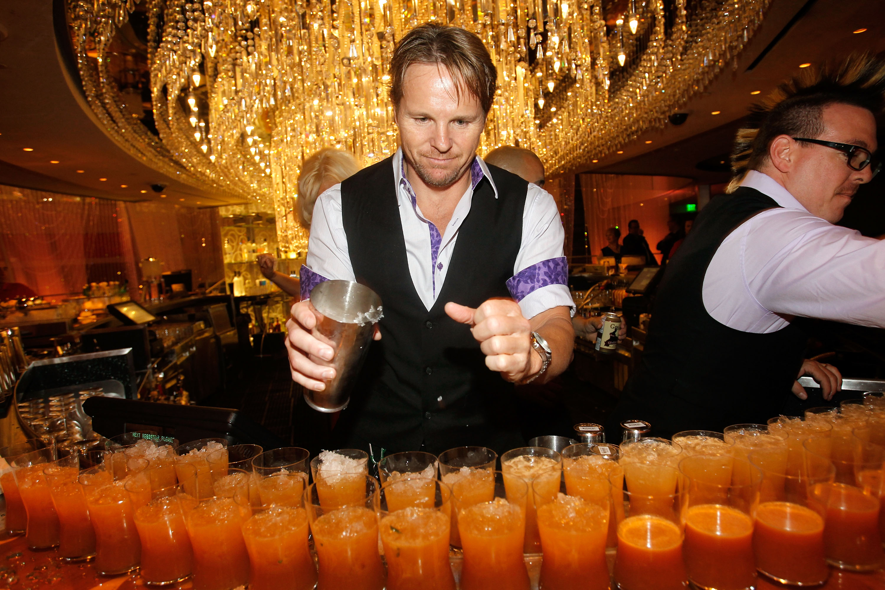 The Cosmopolitan of Las Vegas mixologist serving signature drinks at Uptown/Downtown (photo credit: Isaac Brekken)