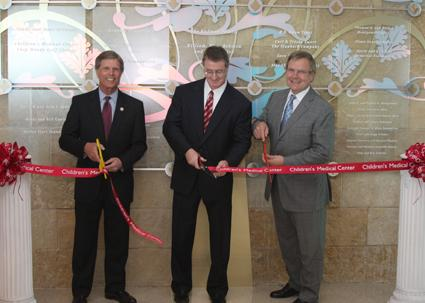 To commemorate Alliance Data's being moved to the million-dollar row of hospital donors, (from left) Phil Dyer, Plano mayor; Ed Heffernan, president and CEO of Alliance Data; and Pete Kline, president of the Children's Medical Center Foundation, hosted ribbon-cutting ceremony at Children's Medical Center at Legacy.