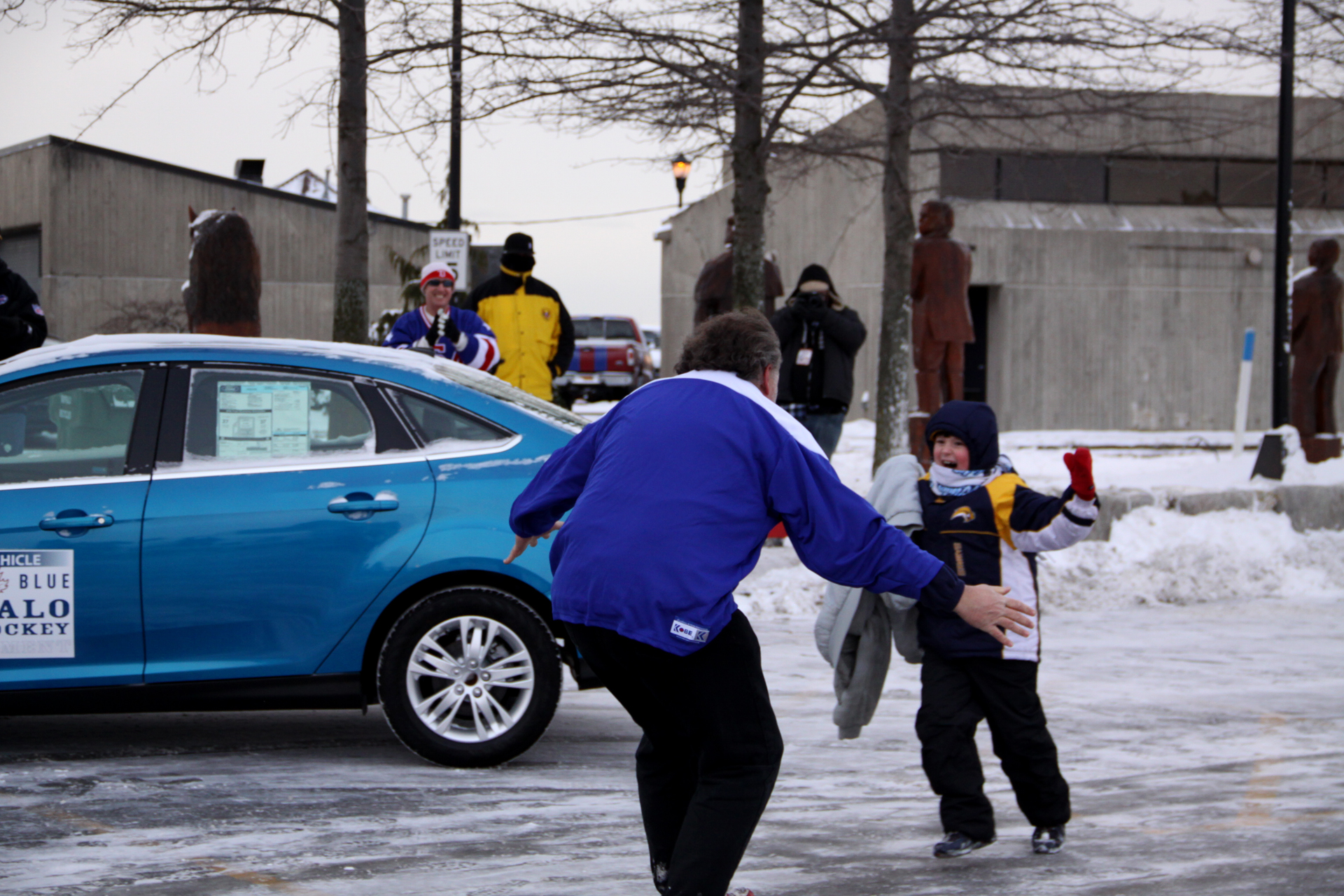 Ford Hockey Shootout winner celebrates with his son after winning a new Ford Focus