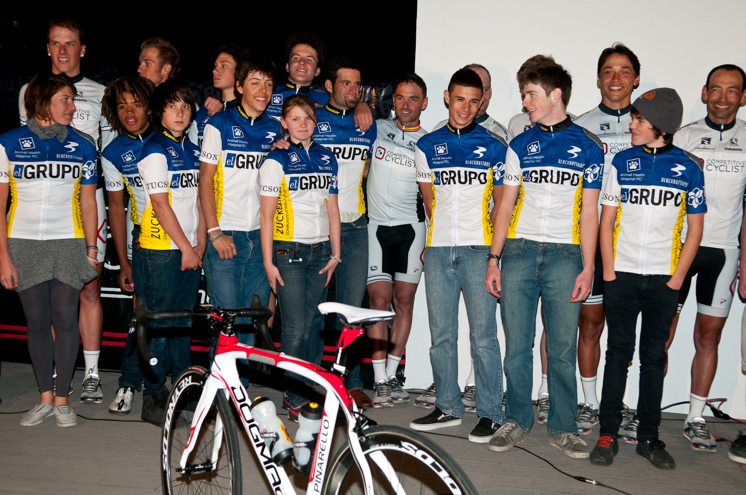 Young riders from El Grupo cycling share time on stage with the pro riders at the official Team presentation. All proceeds from the event benefited El Grupo, a Tucson-based youth cycling program with the mission of exposing local at-risk and undeserved teens to the sport and discipline of bike racing. 