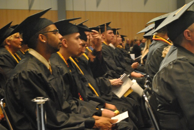 Westwood College graduates listen to the commencement address by Denver Mayor Michael B. Hancock at the Dec. 16, 2011 ceremony.