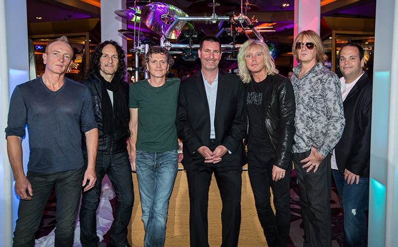Def Leppard Poses with Display at Hard Rock Hotel & Casino