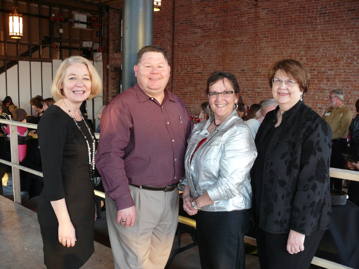 L-R: CEO Roberta Preston, Bartlesville Regional United Way Executive Director Michael Cole, Lee Groth Olson, and Linda Cubbage