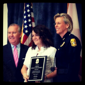 Tampa Mayor Bob Buckhorn & Chief Jane Castor award Corwin Design & Graphics Corporation Tampa Business of the Year.