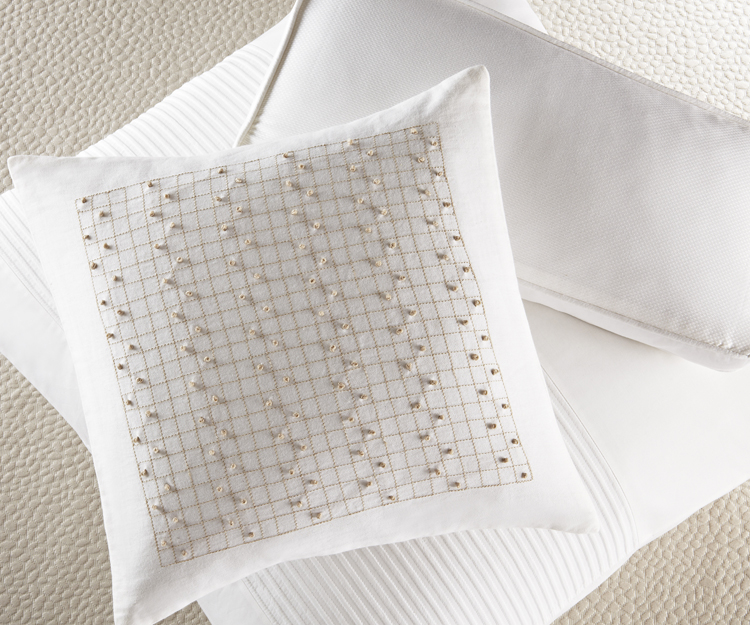 French Knots pillow, sheeting from SIMPLICITY STITCH collection, Barbara Barry Dream Spring 2012.  Photo credit:  Courtesy Barbara Barry Inc.