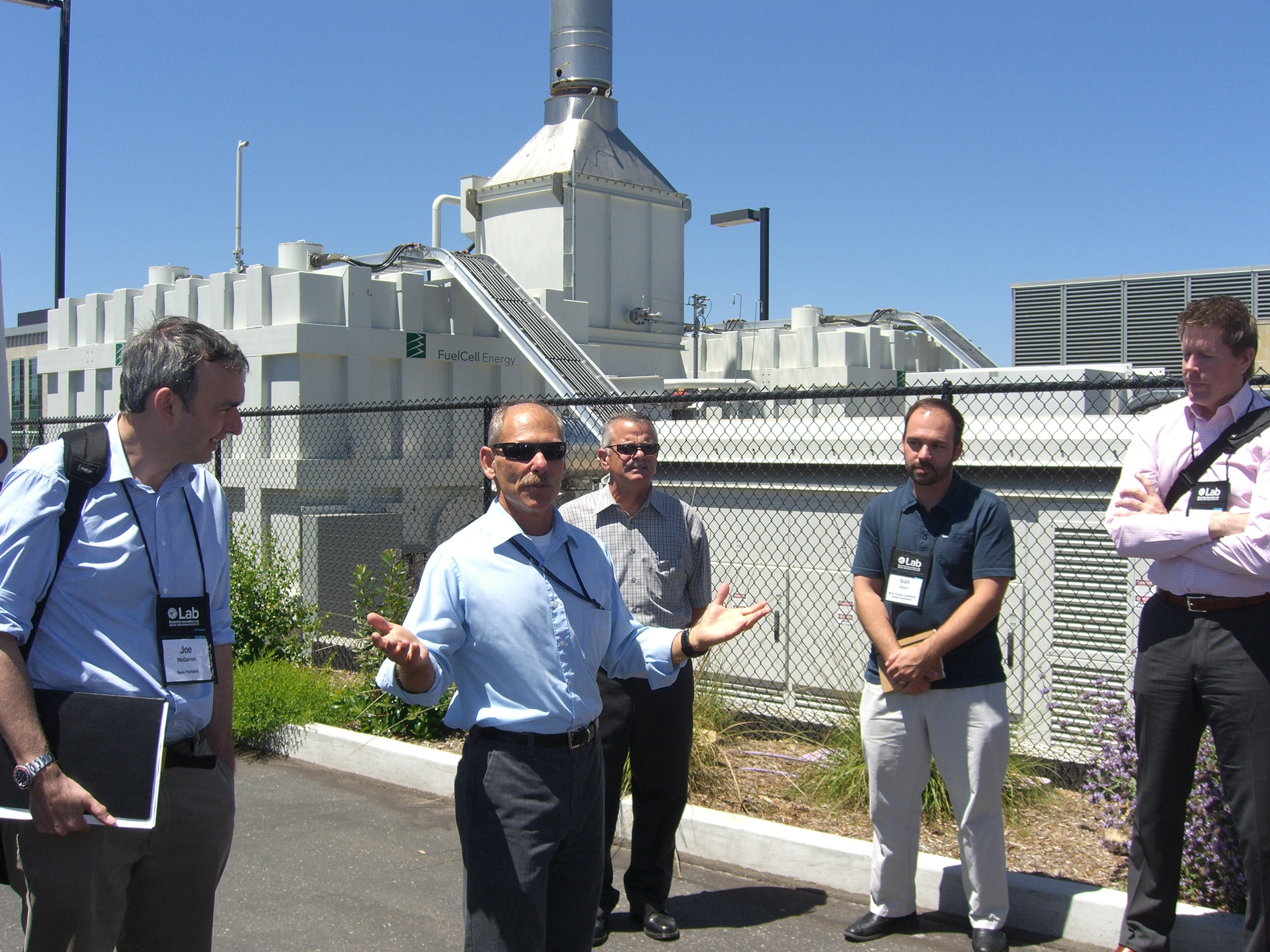 Dave Weil of University of California, San Diego shows eLab participants fuel cells that helped the campus keep the lights on during last year's major blackout in Southern California.