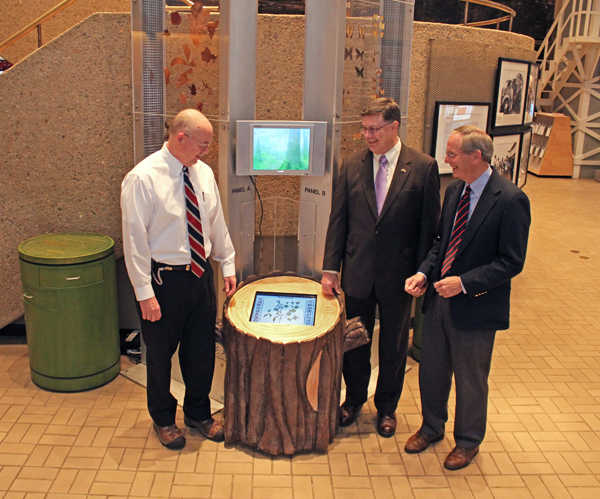The Tree Stump kiosk, purchased by the AMSE Foundation, identifies the various specimens in the Great Smoky Mountains Biodiversity Towers. AMSE Director Jim Comish (left) demonstrates the Tree Stump kiosk touch screen to AMSE Foundation members Bill Klemm, Y-12 Representative (center) and Wayne Stevenson, AMSE Foundation President (right).