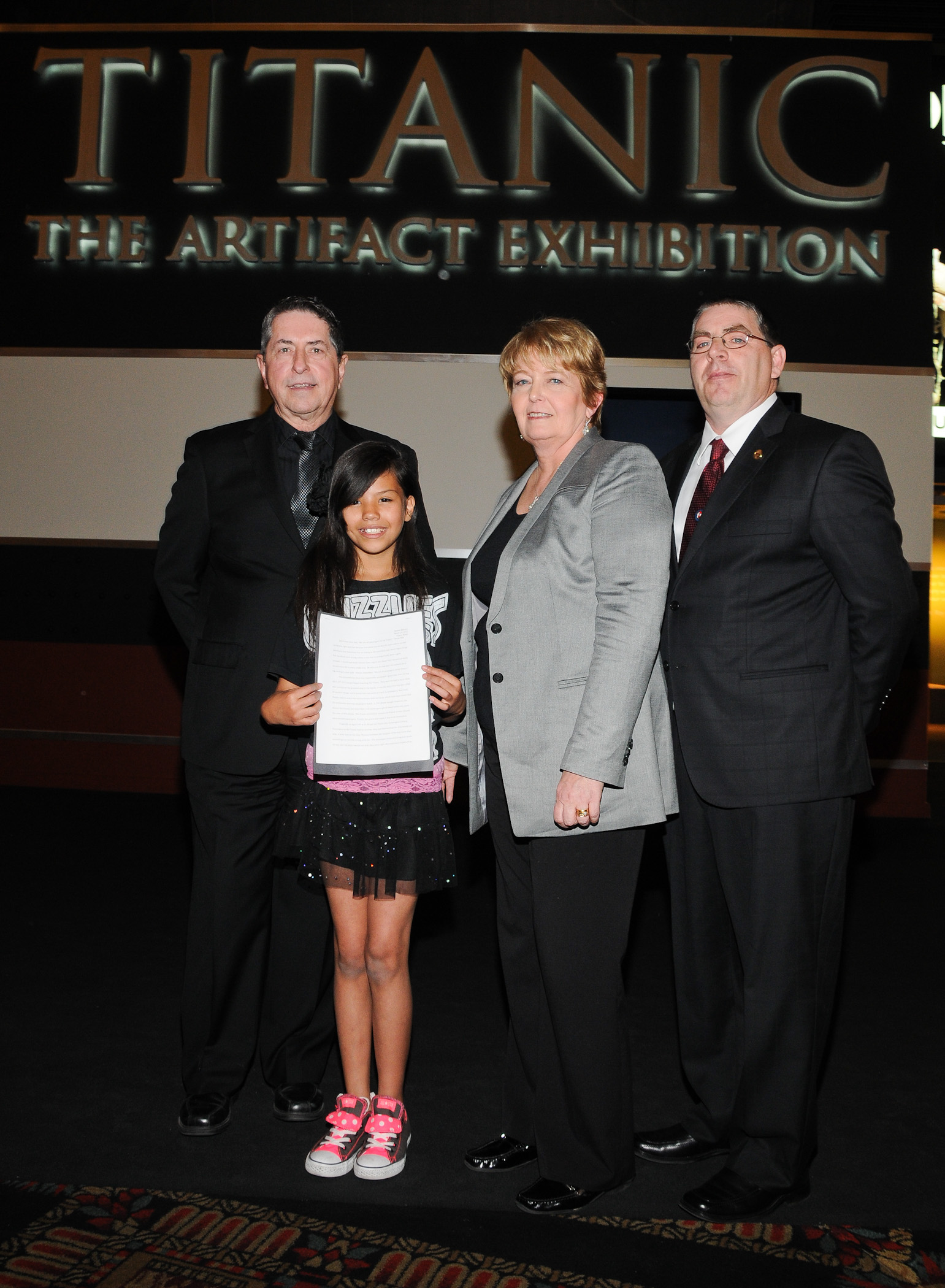 Mike Hartzell, Luxor Hotel and Casino Director of Entertainment, Ayleen Herrera, Titanic essay winner, Alexandra Klingelhoffer, VP of Collections for Premier Exhibitions and RMS Titanic Inc., Tom Goldsmith, descendant of survivor Frank John William Goldsmith