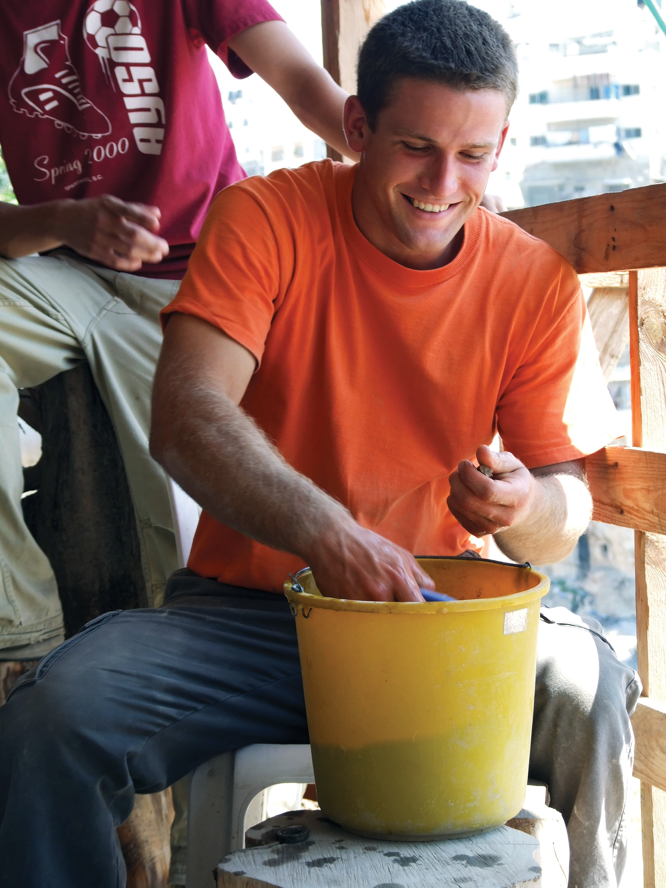 Armstrong College Student, John Rambo, Cleans Pottery at Excavation Site