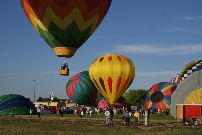 A burst of color hits the sky at dawn Saturday and Sunday when hot air balloons inflate and lift off!